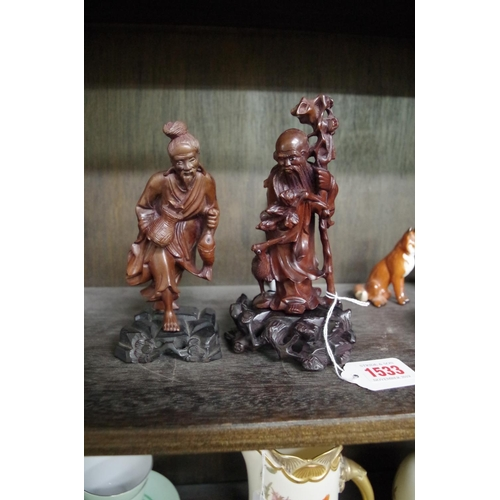 1533 - <strong>Two Japanese carved wood figures,</strong> largest 16cm high....