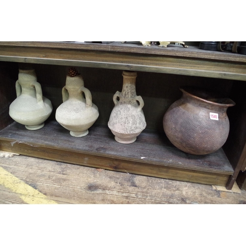 1545 - <strong>Four old pottery vases, </strong>possibly African, 28.5cm high....
