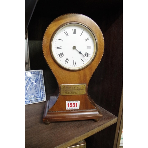 1551 - <strong>An Edwardian mahogany and chequer strung balloon timepiece,</strong>24cm high....