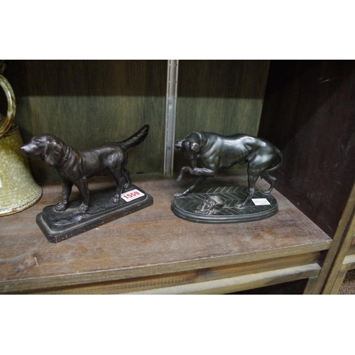 1559 - <strong>Two bronzed metal dogs,</strong>largest 16.5cm wide....