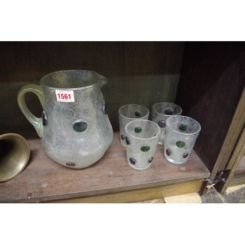 1561 - <strong>A Continental iridescent glass lemonade jug and four beakers, </strong>the jug 20cm high....