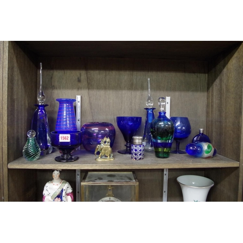 1562 - <strong>A collection of blue glass; </strong>together with an elephant bronze howdah figure, 7.5cm h...