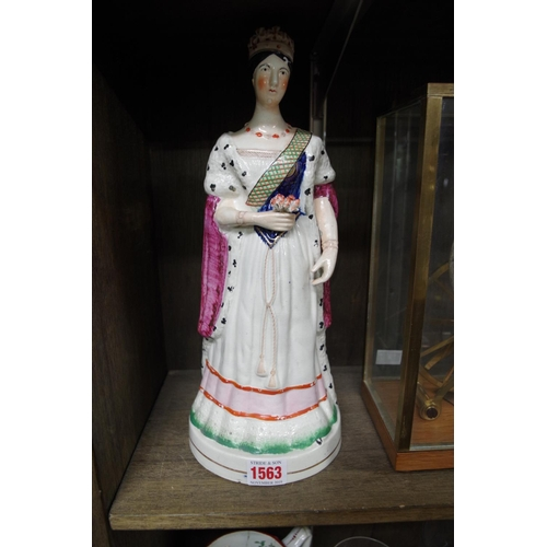 1563 - <strong>A rare Staffordshire pottery figure of Queen Victoria,</strong>33cm high....