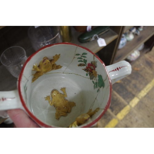 1566 - <strong>A Victorian pottery frog loving cup,</strong> with three frogs to the interior, 12cm high, (...