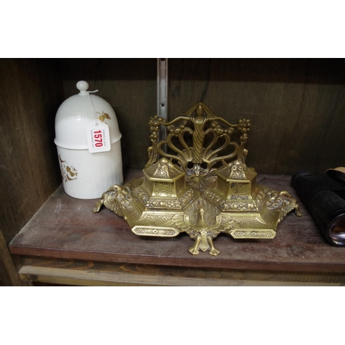1570 - <strong>An antique French cast brass desk stand,</strong>31.5cm wide; together with a Rosentha...