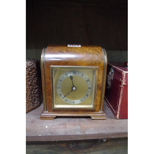 1574 - <strong>A walnut timepiece, </strong>by Elliott, 16cm wide....