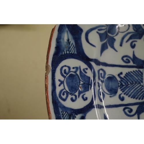 1577 - <strong>An 18th century Continental tin glazed plate,</strong>33.5cm diameter.<str...