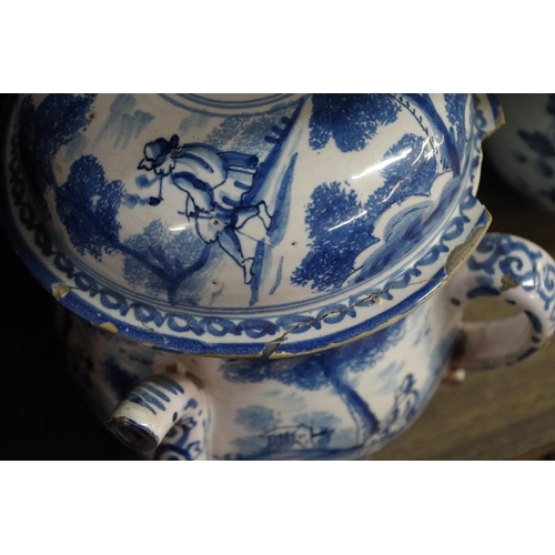 1581 - <strong>A rare 18th century tin glazed posset pot and cover,</strong> 20.5cm high, (s.d.); together ...