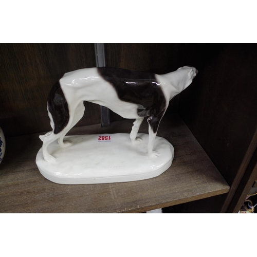 1582 - <strong>A Goldscheider pottery greyhound, </strong>29cm wide....