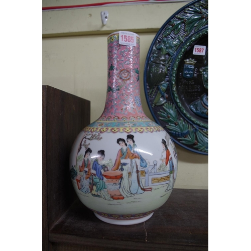 1585 - <strong>A Chinese famille rose bottle vase, </strong>32cm high, (restored)....