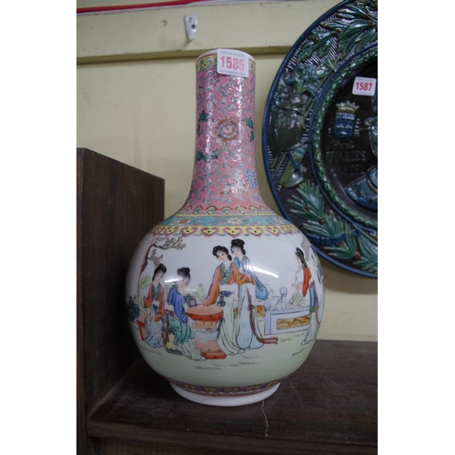 1585 - <strong>A Chinese famille rose bottle vase,</strong>32cm high, (restored)....