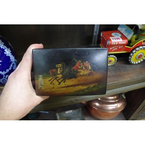 1595 - <strong>A Russian papier mache tea caddy,</strong>14cm wide....