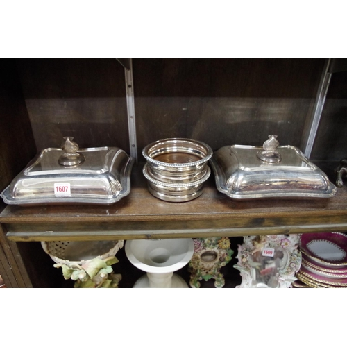 1607 - <strong>An unusual pair of electroplated entree dishes and covers,</strong> the handles of scallop s...