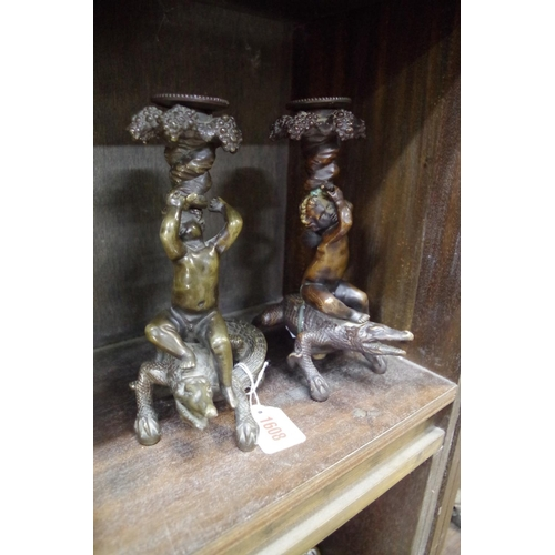 1608 - <strong>Two bronze cherub and crocodile figural candlesticks,</strong>21.5cm high....