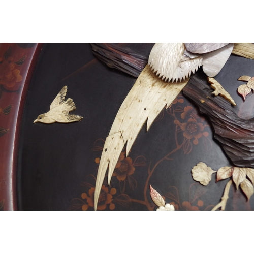 610A - <strong>A pair of Japanese lacquer and shibyama oval panels, </strong>decorated in high relief ...