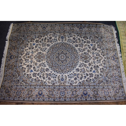 1122 - <strong>A Persian rug</strong>, having central floral medallion, with allover floral field on a crea...