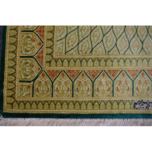 1121 - <strong>A small signed </strong><strong>fine silk Persian Qum rug, </strong>120 x 78cm....