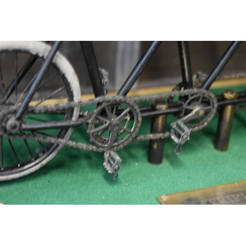 1637 - <strong>Bicycling:</strong>a rare and unusual Victorian scratch built model, bearing label and plaq...