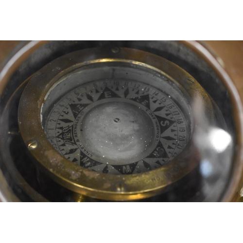 1669 - <strong>An old brass binnacle compass.</strong>...