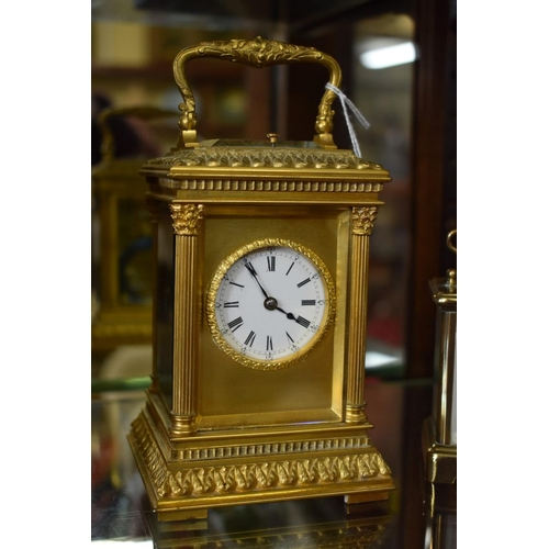 1691 - <strong>A good gilt brass carriage clock, </strong>with push button repeat and gong strike, height i...