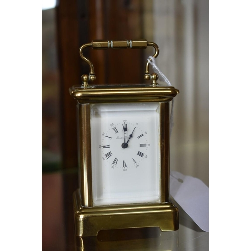 1692 - <strong>An old brass miniature carriage timepiece,</strong> height including handle 10.5cm. ...