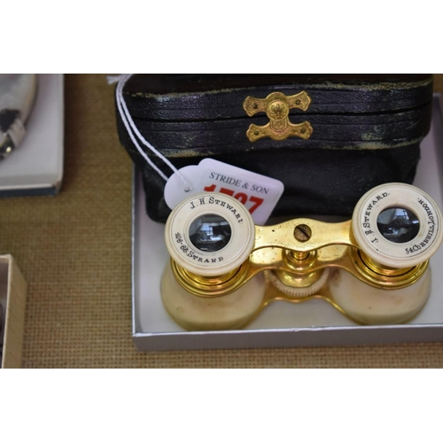 1727 - <strong>A pair of ivory and gilt brass opera glasses,</strong>inscribed 'J H Steward...London'...