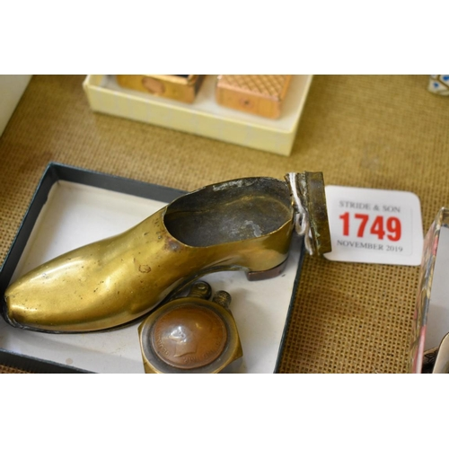 1749 - <strong>Trench Art:</strong>a shoe form snuffbox, 10.5cm long; together with a coin lighter....