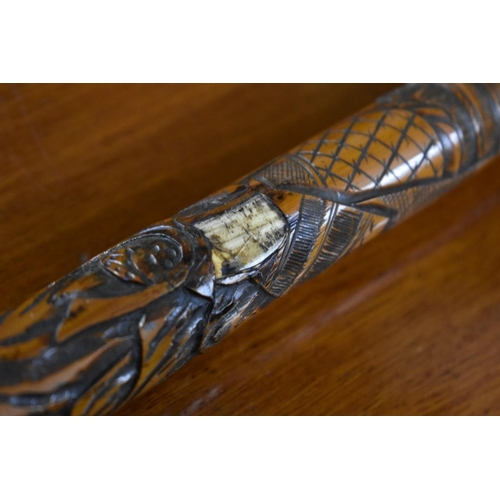 1762 - <strong>A Japanese carved bamboo cane.</strong>...