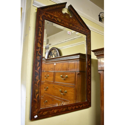 1788 - <strong>An antique Dutch marquetry framed wall mirror,</strong>93.5 x 60.5cm....