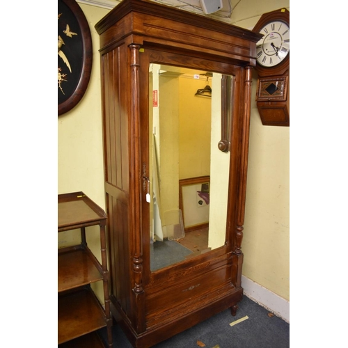 1792 - <strong>A 19th century pitch pine armoire, </strong>with mirror panelled door, 96cm wide....