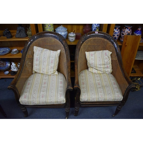 1808 - <strong>A pair of Regency simulated rosewood and cane bergere tub chairs.</strong>...