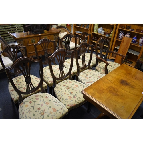 1810 - <strong>A set of eight mahogany shield back dining chairs, </strong>to include an elbow chair....