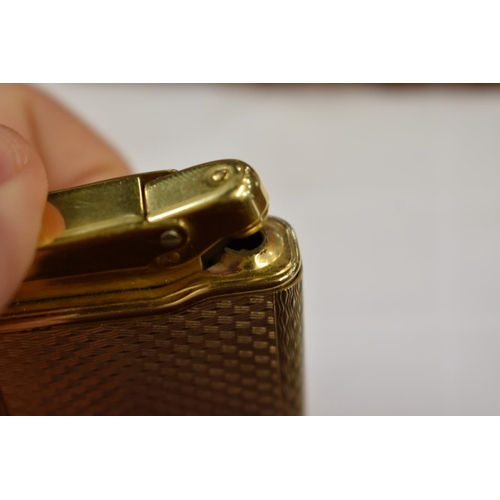 301 - <strong>A Calibri 9ct gold and gilt metal lighter,</strong> removable hallmarked cover 18g....