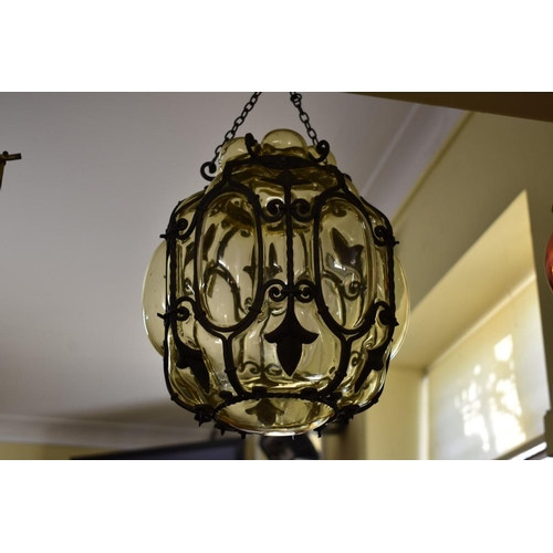 1825 - <strong>A glass and wrought iron hanging lantern,</strong>32cm high....
