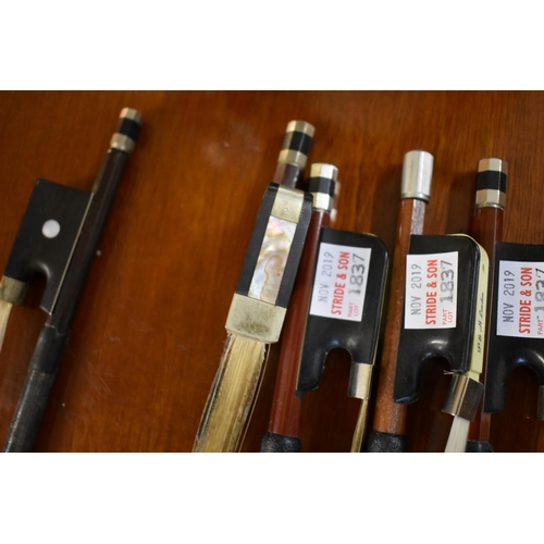 1837 - <strong>Four cello bows;</strong>together with another violin bow, stamped 'Meinl', (broken and res...