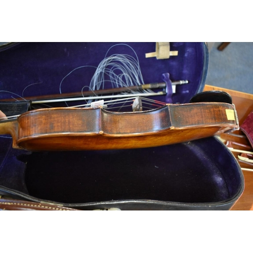 1838 - <strong>An antique Continental violin,</strong>with 14in single piece back, with bow, in Hawkes &am...