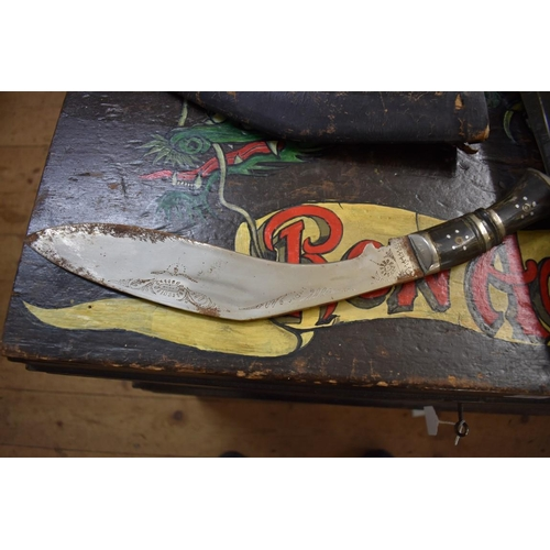 1844 - <strong>A kukri and sheath;</strong> together with an Indian carving knife and sheath; two old trunc...