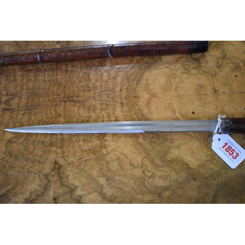 1853 - <strong>An old leather covered swagger dagger stick,</strong>28.5cm blade....