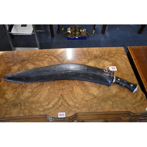 1858 - <strong>A large Nepalese Gurkha panawal sirupate kukri and scabbard,</strong> having 59cm blade....
