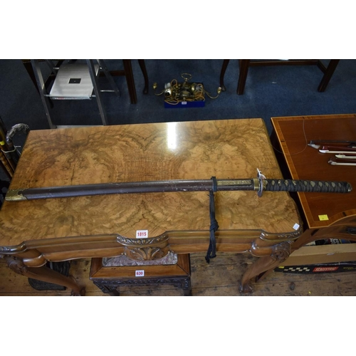 1863 - <strong>A reproduction of a Japanese katana and scabbard</strong>, 69cm blade....
