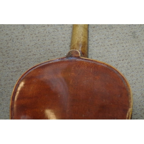 1840A - <strong>An oldmandolin,</strong> labelled 'Guiseppe Casini', in case; together with a 14in violin, ...