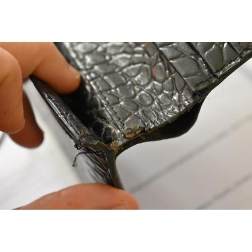 1730 - <strong>A Hermes Bearn bi-fold black alligator wallet,</strong>19cm wide....