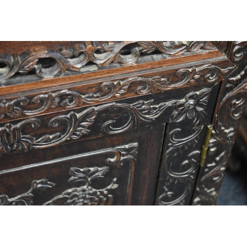 613 - <strong>A good Chinese carved and pierced hardwood display cabinet,</strong> <em>late 19th century,<...