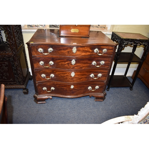 1786 - <strong>A George III mahogany serpentine fronted chest of drawers,</strong>with fitted top dra...