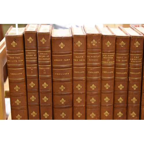 606 - <strong>TROLLOPE (Anthony): </strong>'The Works': 49 vols: 8vo, uniform tan half calf, gilt ruled/le...