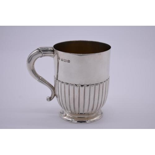 11 - <strong>A silver Christening mug</strong>, by <em>Elkington & Co Ltd,</em> Birmingham 1911, gilt...