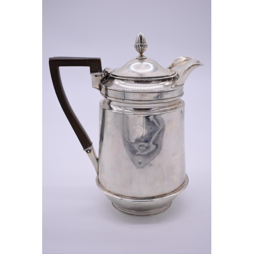24 - <strong>A George III silver hot water jug,</strong> by <em>John Eames</em>, London 1805, having acor...