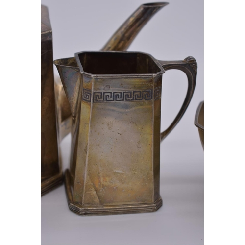 28 - <strong>An Arts & Crafts sterling silver three piece teaset,</strong>having niello plaque ...