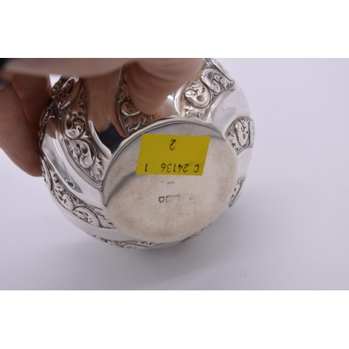 36 - <strong>A repousse silver sugar bowl,</strong>London marks indistinct, 5.5cm high, 74.5g....