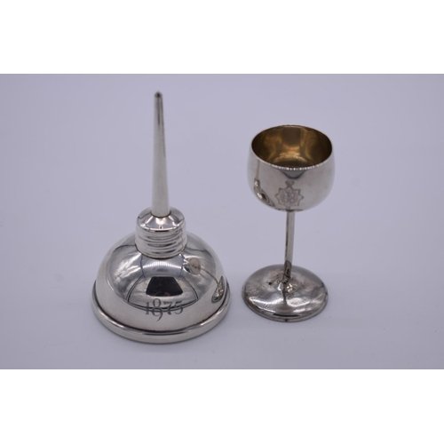37 - <strong>A sterling silver oil dropper,</strong> by <em>T</em><em>iffany, </em>9cm high; together wit...